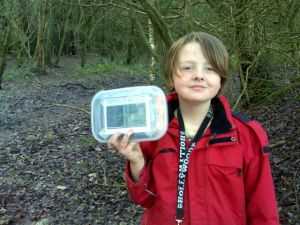 Isaac with a tupperware type geocache
