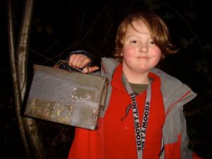 Isaac with a typical geocache - an ammo box