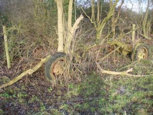 Old vehicle remains near a cache