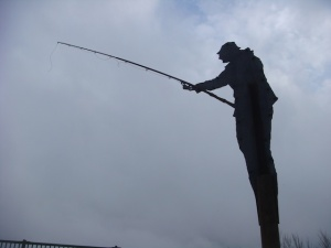 FIshing man statue near one of the caches