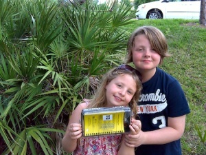Isaac and Freya with a cache in Celebration, FL