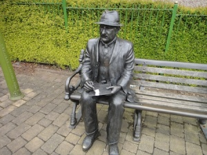 L.S. Lowry signs the logbook (or is he sketching some matchstick men and matchstick cats and dogs ;-))