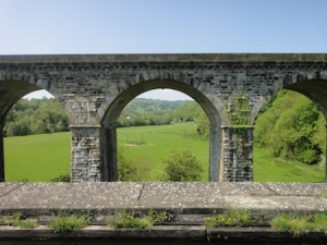 Chirk railway bridge viewed from Chirk Aquaduct. The railway bridge was deliberately built higher so as to make it look more superior to the canal.