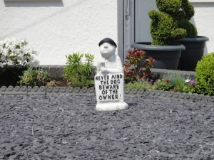 "Funny sign in a front garden we passed - ""Never mind the dog, beware of the owner!"""