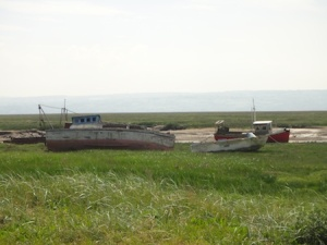 Boats on the silted up Dee Estuary at Heswall