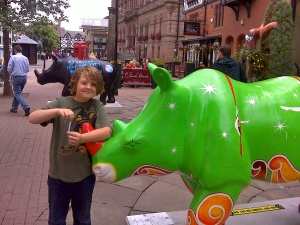 Isaac with the Chester Challenge logbook. Love these rhinoceroses that are dotted everywhere round the city centre.