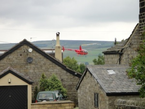 Red helicopter that was buzzing the houses and scaring the sheep in the fields