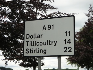 This sign amused us - not often you get two currencies named on one road sign!