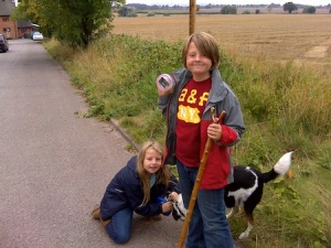 Isaac, Freya and one of our dogs with one of the sneaky caches